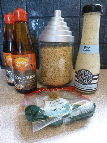 Picture of some less successful frugal purchases I've made from Approved Food, the discount food website, including Golden sunrise soy sauce,giant cous couse and Pizza Express light salad dressing.