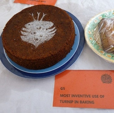 Picture of my prize-winning cake for most inventive use of turnip in baking, with a turnip in icing sugar decoration