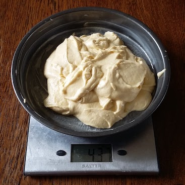 Picture of cake mix inside a baking tin on my digital scales