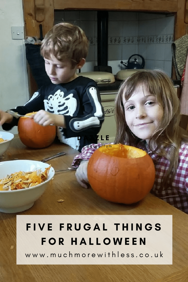 Pinterest image for five frugal Halloween things with my children carving pumpkins