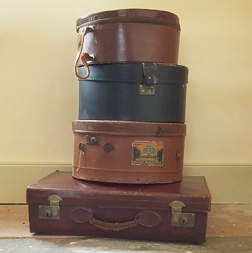Vintages suitcase and hatboxes as Much More With Less moves to a new domain and new website