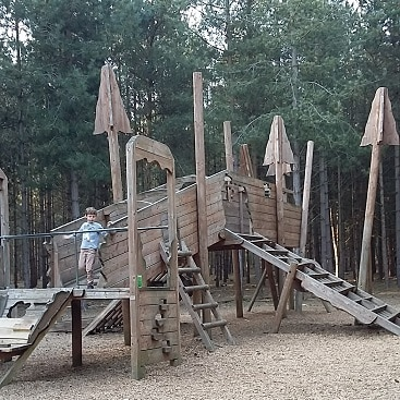 Picture of the amazing wooden adventure playround in Rendlesham Forest, with a huge wooden climbing frame like a crashed plane