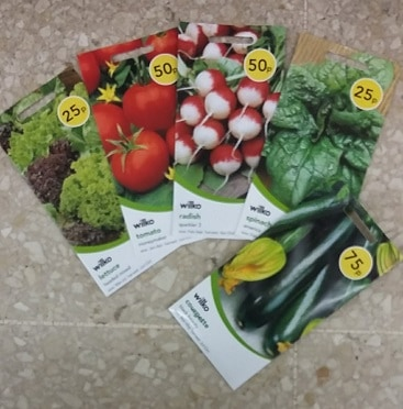 Picture of packets of cheap seeds from Wilko, from 25p for salad leaves, 50p for tomatoes, radishes and spinach, and 75p for courgettes