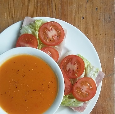 Picture of a bowl of squash and pepper soup in a bowl, with ham salad sandwich thins on a plate, as the first day of my WeightWatchers frugal weight loss diet
