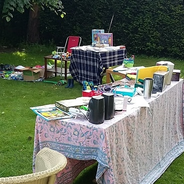 Picture of tables set up with all the stuff we wanted to sell at a successful yard sale