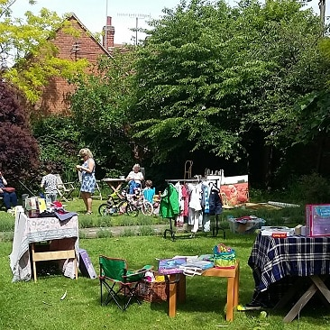 Picture of the children and stalls set out in our garden for a yard sale