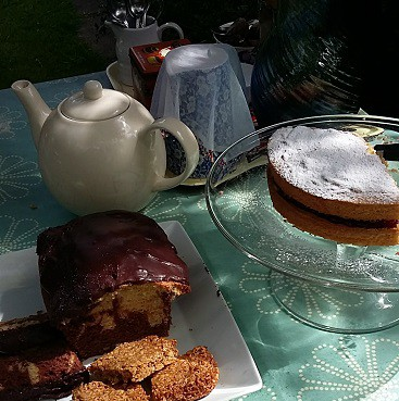 Picture of a tea pot and milk jug with flapjack, Victoria Sponge cake and marble cake at our yard sale