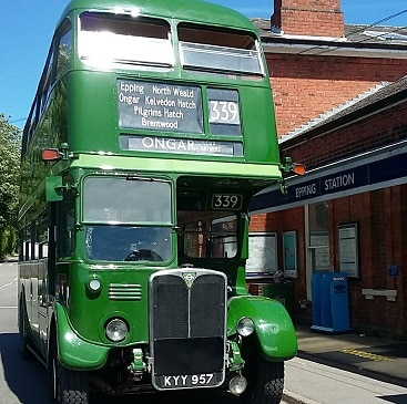 Picture of a green routemaster bus at Epping Station