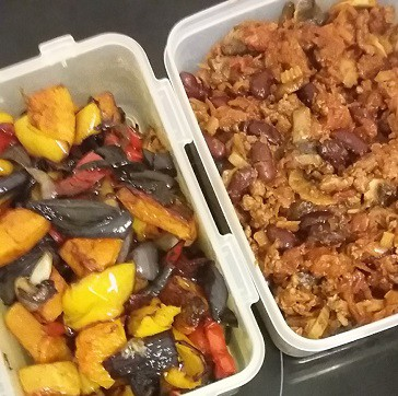 Picture of one plastic box with roasted vegetables next to another of chill con carne when I did batch cooking to save money and time