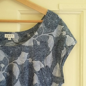 Picture of a blue patterned floral dress from EAST, bought for less at the EACH charity shop in Hadleigh