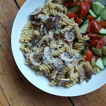 Picture of pasta meal made with yellow-stickered discount mushrooms and salad, made with minimal effort and less cost