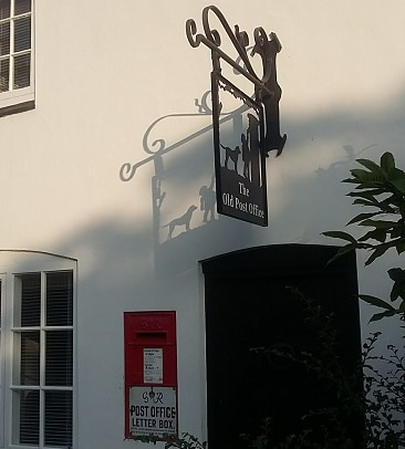 Picture of the iron Old Post Office sign in Burton Overy, a useful amenity when moving to the country