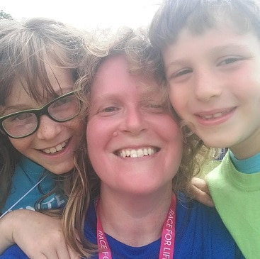Photo of me with my children, right after finishing my first 10K race, the Chelmsford Race for Life