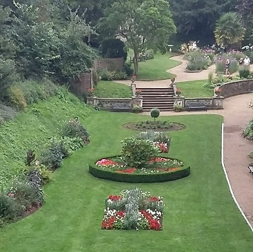 Picture of flowerbeds and lawns in Plantation Garden in Norwich, visited as part of #lettheadventurebegin with Greater Anglia