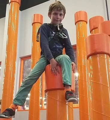 Picture of my son part way up the stairway to heaven at Gravity Rocks urban climbing
