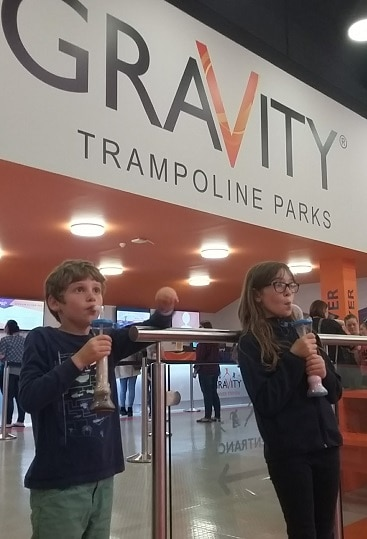 Picture of my children with their refillable drinks during the safety briefing at Gravity trampoline park in Norwich part of #lettheadventurebegin with Greater Anglia