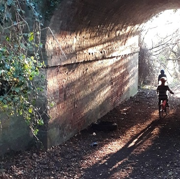 Picture of my children riding through a tunnel when we were out for a country walk