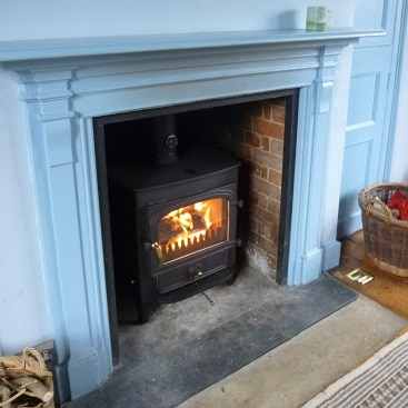 Picture of the wood burner after it was fitted in our blue room