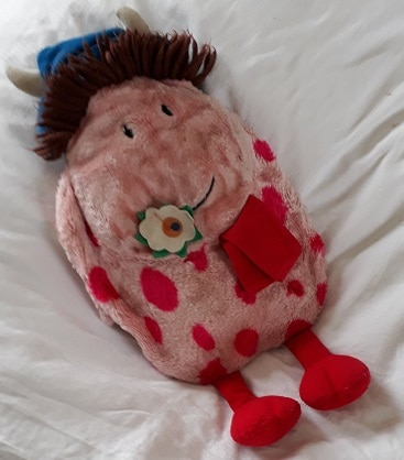 Picture of a pink fun fur Ermintrude hot water bottle cover.