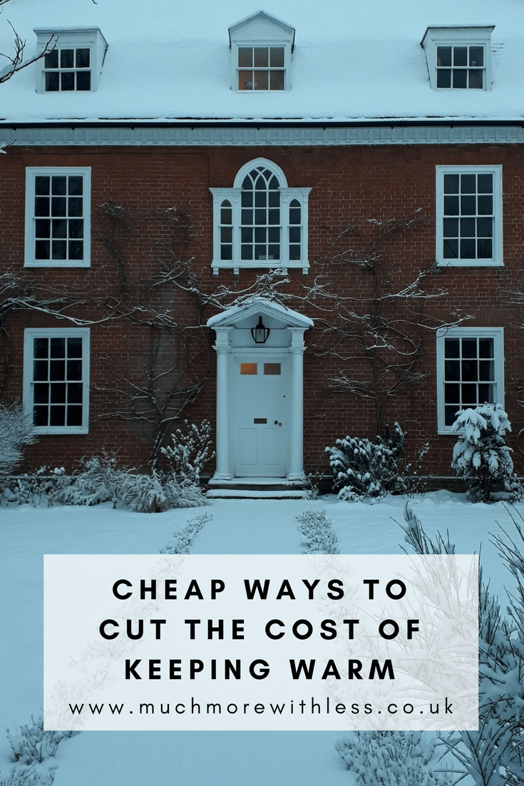 Pinterest size picture of our house in the snow to illustrate a post about cheap ways to cut the cost of keeping warm