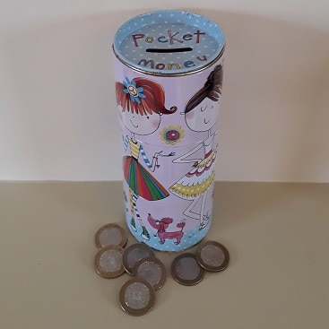 Picture of a pink moneybox with lots of coins to illustrate a post about women being ready to start investing