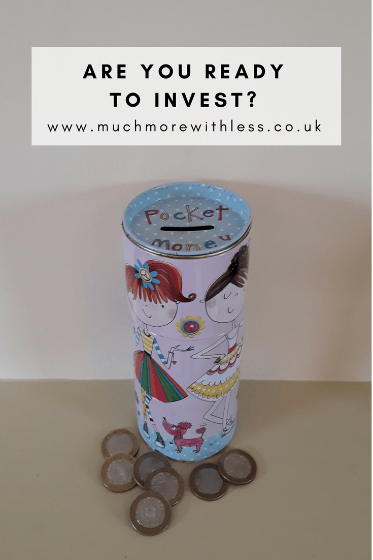 Pinterest size image of a pink moneybox and coins for a post asking are you ready to invest?