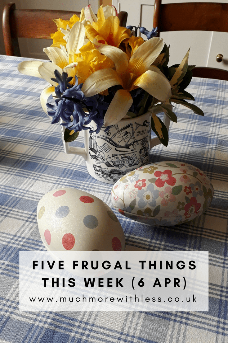PInterest size image of mug of flowers and easter egg shape tins on a table for my five frugal things this week post