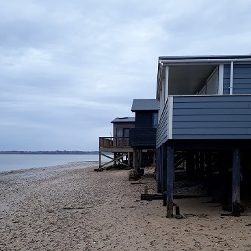 Picture of beach huts and shoreline at Wrabness