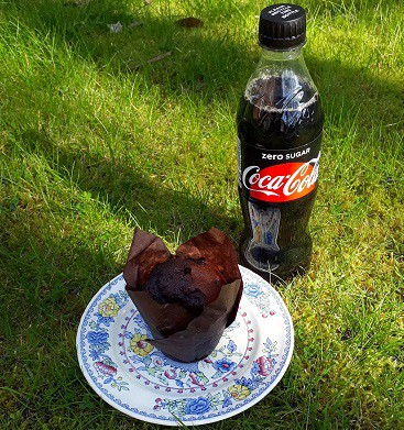 Photo of a chocolate muffin and bottle of zero sugar coca cola, free via the Greggs Reward app on my birthday