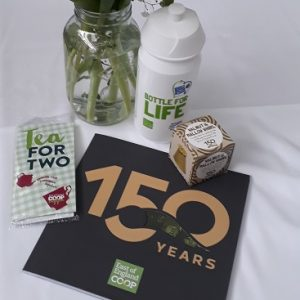 Picture of the contents of the goody bag from the East of England Co-op including tea bags, mallow whirl, bottle for life and book about 150 years of the Co-op
