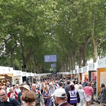 Picture of crowds and stalls for my post on how to visit Chelsea Flower Show for less