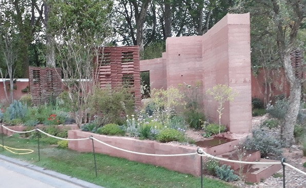 Picture of the M&G show garden for Chelsea Flower Show, with rammed earth walls