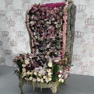 Picture of a flower covered throne, one of the floristry displays at Chelsea Flower Show