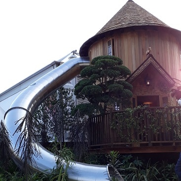 Picture of a tree house with slide at Chelsea Flower Show