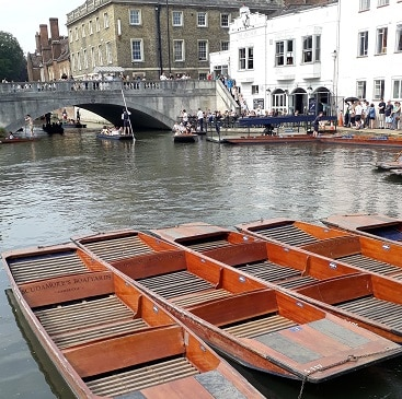 Picture of punts on the Cam, with Silver Street bridge and the Anchor pub during our trip to Cambridge by train