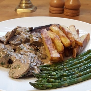 Picture of the meal I cooked for Fathers Day with Sourced Locally food: steak, mushroom sauce, chips and asaparagus