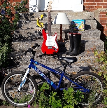 Picture of items to sell including a bicycle, guitar, wellies and toys for my post with expert tips when buying and selling on Gumtree