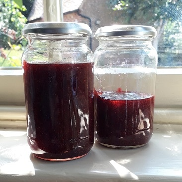 Picture of a jar and a half of strawberry jam on my windowsill for my post on how not to make strawberry jam
