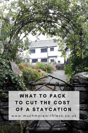 Pinterest sized image of an english cottage for my post on what to pack to cut the cost of a staycation
