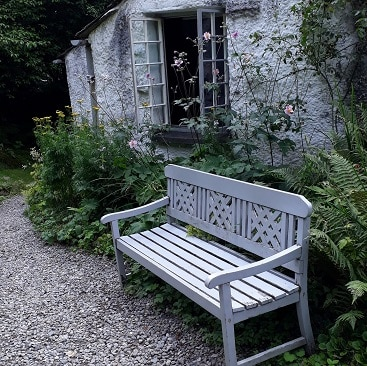 Picture of bench in the garden at Dove Cottage for my post on five frugal things on holiday
