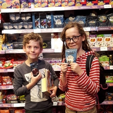 Picture of my children in Kingdom of Sweets one of our frugal things during a trip to London