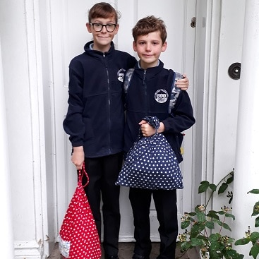 Picture of my children in school uniform on their first day back at school