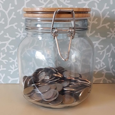 Picture of a kilner jar filled with coins