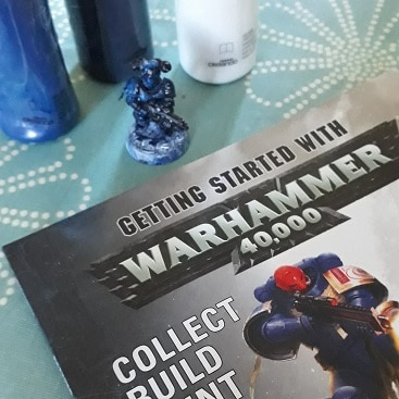 Picture of Warhammer magazine and model, with acrylic paints we already had