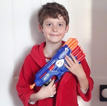 Picture of my son in a dressing gown carrying the Nerf gun he bought from a charity shop
