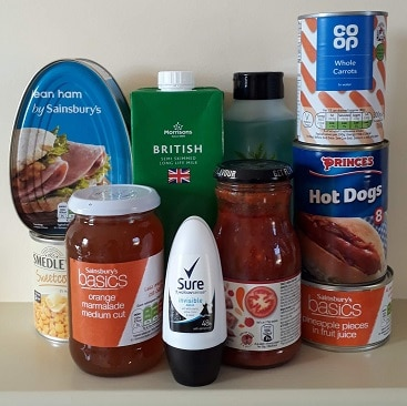 Picture of tins, jars, cartons and bottles to donate to a food bank