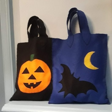 Picture of our Halloween trick or treat bags featuring a pumpkin, bat and moon