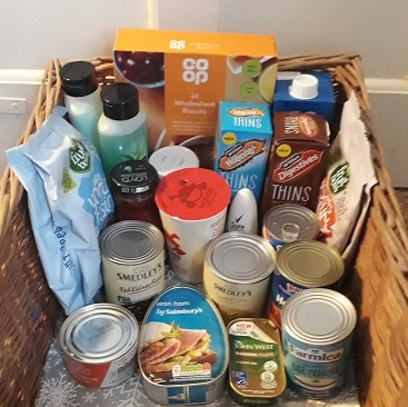 Picture of the tins, packets and toiletries I'm putting in a box each day, as a reverse advent calendar to support my local food bank