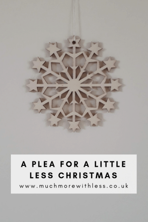 Pinterest size image of a wooden snowflake decoration for my post with a plea for a little less Christmas
