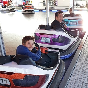 Picture of my son, husband and daughter lined up in dodgems at The North Pole in Cambridge